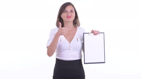 Thumbnail for Happy Beautiful Businesswoman Showing Clipboard and Giving Thumbs Up