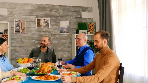 Thumbnail for Happy and Cheerful Family Enjoying a Delicious Dinner