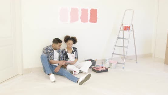 Thumbnail for Young Couple Use Tablet To Discuss Colors