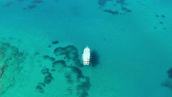 Aerial View of a Boat in the Blue Sea