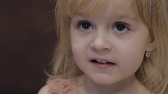 Happy Three Years Old Girl. Cute Blonde Child. Brown Eyes. Cute Girl Make Faces