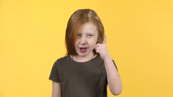 Thumbnail for Little Girl Showing Emotion Punishment, Compositing on Yellow Background. Slow Motion