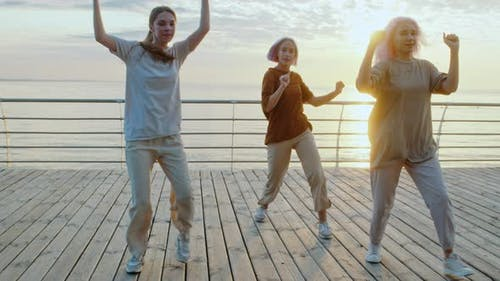 Dancing Group of Young Talented Freak Women Performing Freestyle Hip-hop Moves. Girls Enjoying