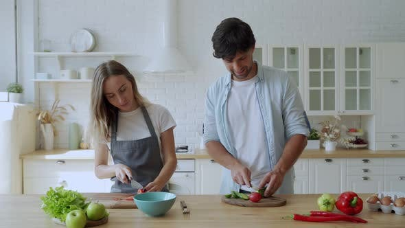 Thumbnail for Young Happy Couple Is Enjoying and Preparing Healthy Meal in Their Kitchen