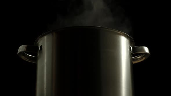 Thumbnail for Large Saucepan Boiling With Steam On A Black Background