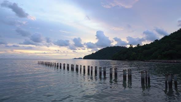 Broken bridge pole at sea coastal
