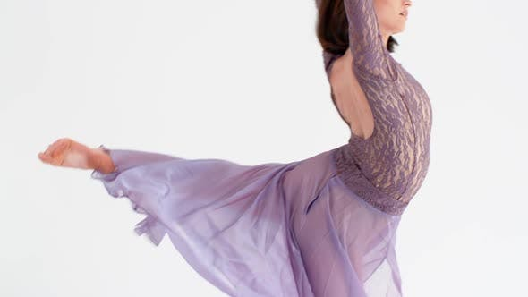 Cover Image for Young Woman in a Purple Dress Dancing Modern Contemporary Style