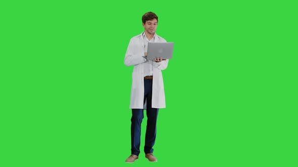 Thumbnail for Male Doctor in White Coat Having Video Conference on His Laptop on a Green Screen, Chroma Key.