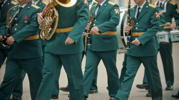 Thumbnail for A Wind Instrument Military Parade - People in Green Costumes Walking on the Street Holding Musical