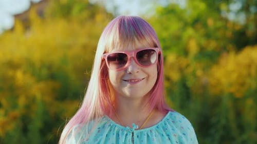 Portrait of a Girl with Pink Hair in Pink Sun Glasses