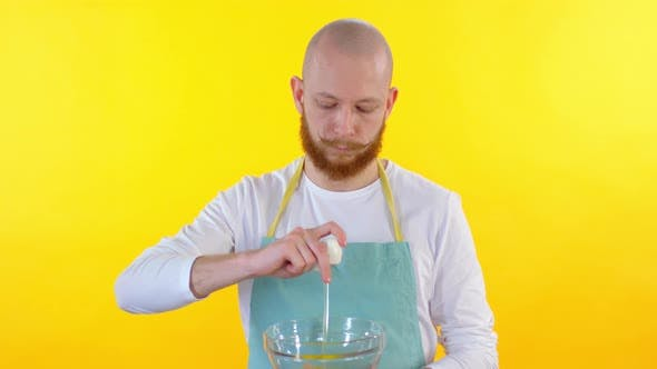 Thumbnail for Man Cracking Egg into Glass Bowl
