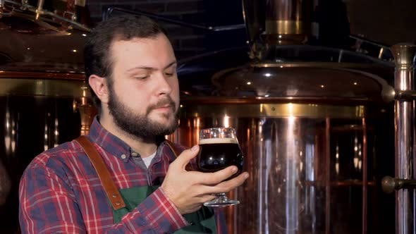 Thumbnail for Beer Maker Drinking Delicious Dark Beer, Smiling To the Camera