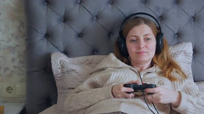 Woman Playing On A Console