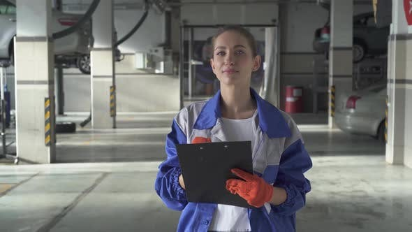 Thumbnail for Young Woman Assistance Writing Important Information About Car Fro Test and Control in Modern Car