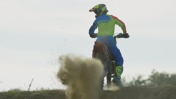 Thumbnail for Motocross driver leaving dust behind