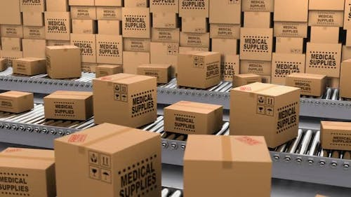 Cardboard Boxes with Medical Supplies and Donations on the Conveyor Belt