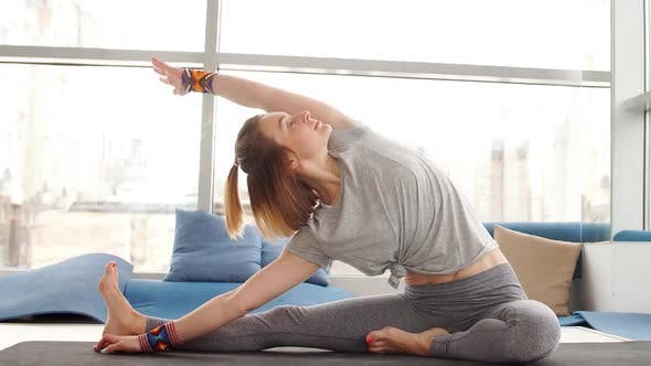 Young Woman Doing Yoga in Studio