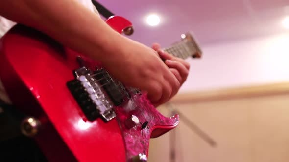 Thumbnail for Close-up of Male Guitarist Hands Playing on Red Electric Guitar