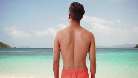 Thumbnail for Tourist looking out over Caribbean Ocean on tropical vacation