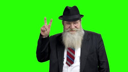 Senior Businessman Showing Peace Gesture