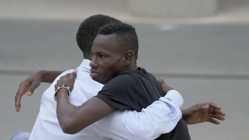 friendship, complicity, support. African man comforting his sad friend