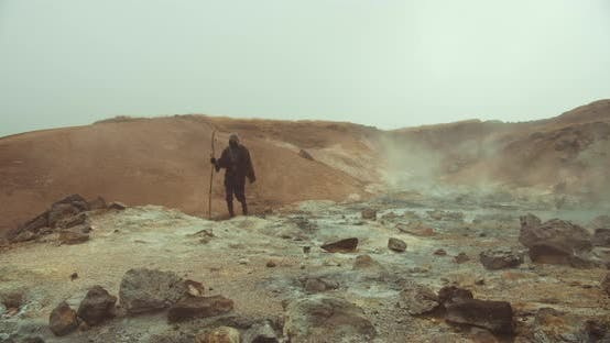 Mysterious Figure In Desert Landscape