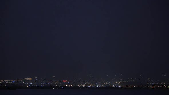 Thumbnail for Lightning Strikes Over the City at Night