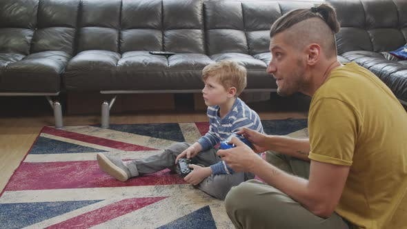 Slowmo of Father and Son Playing Video Game