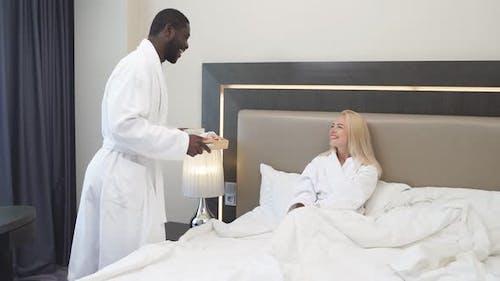 Generous Kind Man Brought Breakfast To Bed To His Beloved Girlfriend.