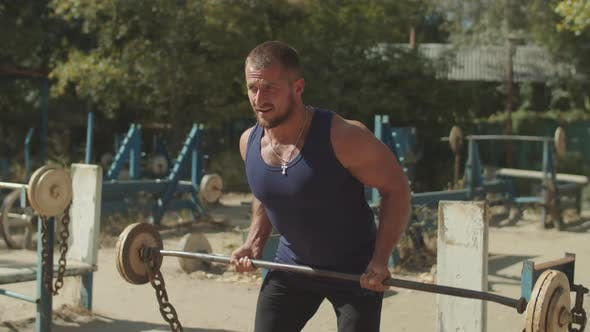 Thumbnail for Bodybuilder Doing Deadlift Exercise at Outdoor Gym