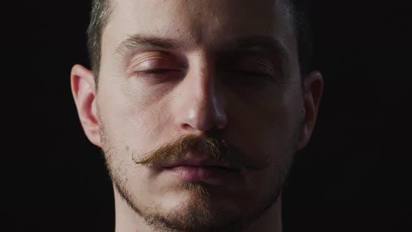 Thumbnail for Man opening and closing eyes