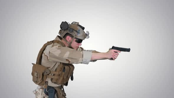 Modern Soldier Counter Terrorist Squad Fighter Aiming and Shooting with Pistol on Gradient