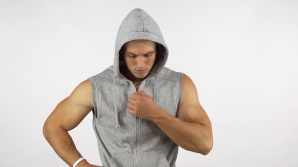 Thumbnail for Strong Muscular Man Wearing Hoodie, Looking Fiercely To the Camera 1080p