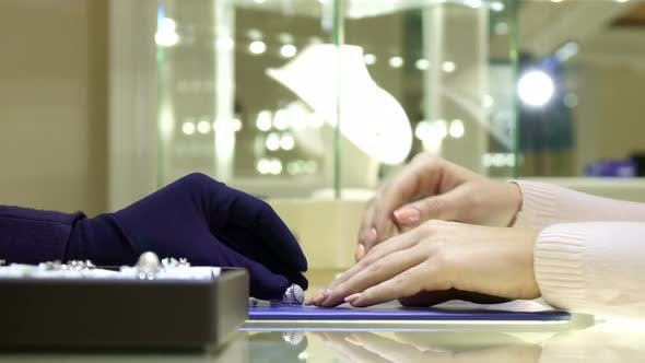 Cover Image for Female Customer Chooses Ring at the Jewelry Boutique