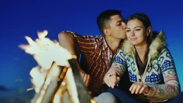 Thumbnail for A Loving Young Couple Sitting on the Beach Campfire
