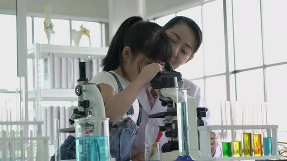 Woman and girl in laboratory
