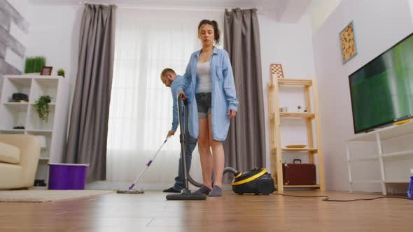 Woman Cleans-up the Floor