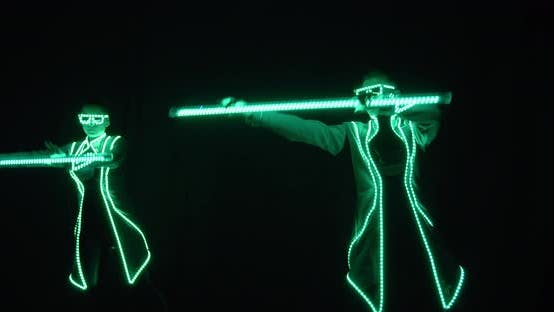 Thumbnail for Two People Are Performing a Light Show on Stage of the Nightclub,