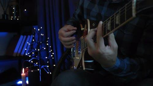 Professional guitarist plays romantic lyric ballad on electric guitar