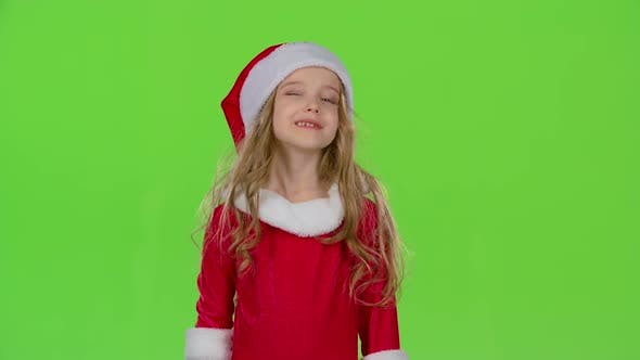 Thumbnail for Kid in a Red Suit Are Standing in the Room and Wink. Green Screen