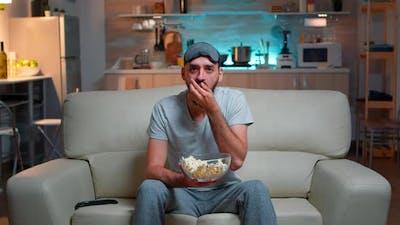 Portrait of Man with Beard Holding Popcorn Bowl