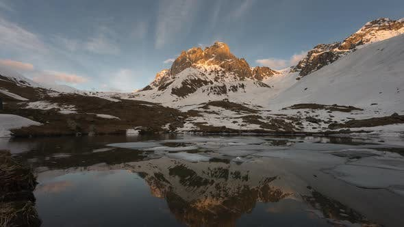 Thumbnail for Time-lapse of Sunset in Snowy Mountains. There Is a Lake with Ice Floes