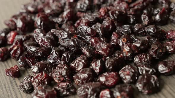 Thumbnail for Panning over  red cranberries on table 4K 2160p 30fps UltraHD footage - Close-up of dried berries of