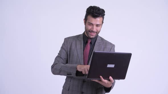 Thumbnail for Happy Bearded Persian Businessman Using Laptop