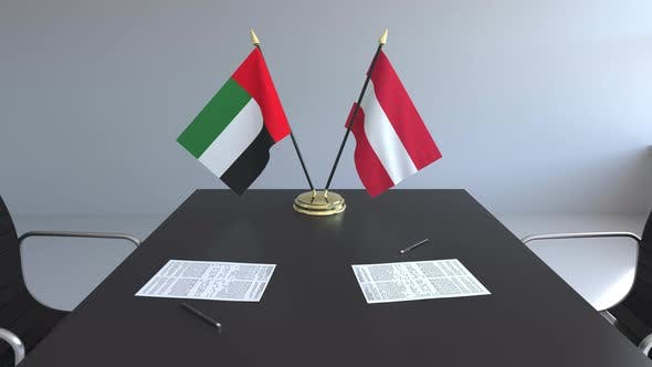 Flags of the United Arab Emirates and Austria on the Table