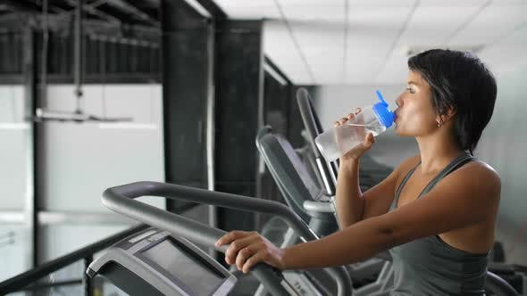 Thumbnail for Asian Woman Drinking Water in Gym