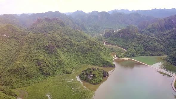 Thumbnail for Drone View Hilly Islands with Jungle Road Separating Sea