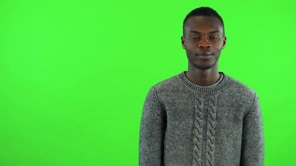 Thumbnail for A Young Black Man Agrees at the Camera with a Smile - Green Screen Studio