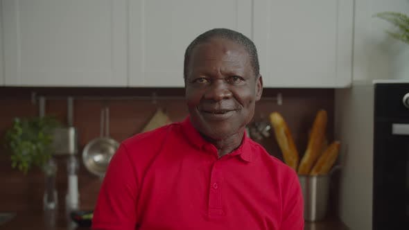 Portrait of Elderly Black Man Smiling Indoors