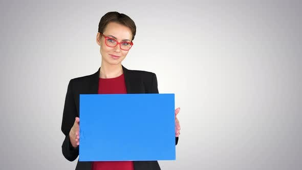 Thumbnail for Businesswoman Holding an Empty Banner on Gradient Background.